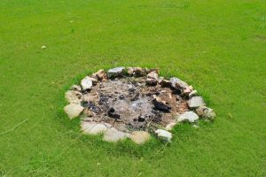 Fire Pit With a Ring of Rocks Around It