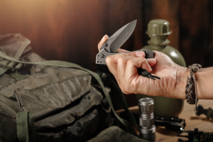 Man Holding a Folding Blade Knife