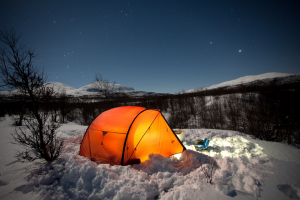 Winter Camping Tips - Candle at Night
