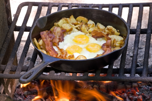 Cooking Scrambled Eggs over campfire.