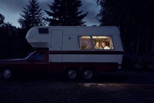 A Family Using Generator Power in an RV at Night