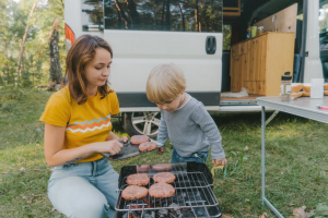 Family Cooking Burgers on an RV Grill