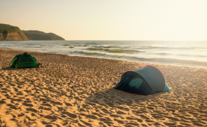 Two Tents on the Beach by the Ocean