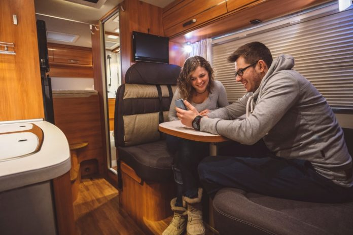 Young Couple Using WiFi in an RV
