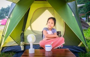 Girl Using Portable Fan In a Camping Tent