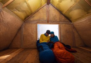Young Couple in Sleeping Bags While Camping in Winter