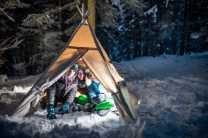 Kids Camping Inside of a Teepee Tent
