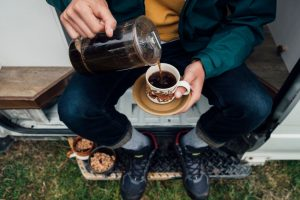 Pouring French Press Coffee While Camping
