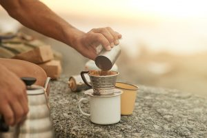 Man making pour over coffee outdoors